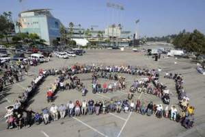 People roll through a parking lot near Dodger Stadium in Los Angeles as they celebrated the anniversary of the Americans with Disabilities Act in this file photo.